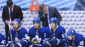 Toronto Maple Leafs head coach Sheldon Keefe, top centre, reacts after his team gives up the second goal of the game to the Columbus Blue Jackets during third period NHL Eastern Conference Stanley Cup playoff action in Toronto on Sunday Aug. 9, 2020. THE CANADIAN PRESS/Nathan Denette