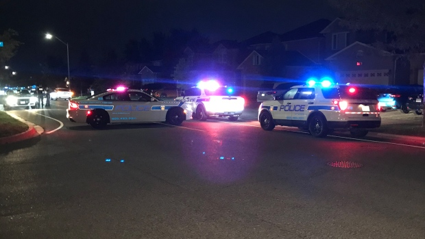 Police are seen on River Grove Avenue on Aug. 10, 2020 after a stabbing. (Mike Nguyen/CP24)