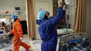 In this Tuesday, June 16, 2020, photo, nurses tend to COVID-19 patients at the Shohadaye Tajrish Hospital in Tehran, Iran. (AP Photo/Vahid Salemi)
