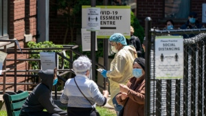 Patients are assessed as they line up at a Covid-19 Assessment Centre in Toronto on Sunday May 31, 2020. THE CANADIAN PRESS/Frank Gunn