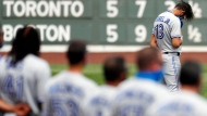 Toronto Blue Jays' Lourdes Gurriel Jr. (13) stands for the Canadian national anthem before a baseball game against the Boston Red Sox, Sunday, Aug. 9, 2020, in Boston. (AP Photo/Michael Dwyer)