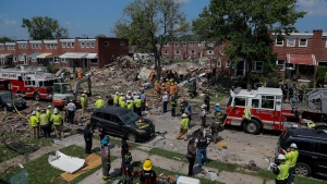 The aftermath of an explosion in Baltimore on Monday, Aug. 10, 2020. Baltimore firefighters say an explosion has levelled several homes in the city. (AP Photo/Julio Cortez)