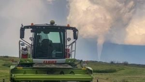 A funnel cloud is seen in the distance of a farmer's field near Virden, Man., in a Friday, Aug. 7, 2020, handout photo. THE CANADIAN PRESS/HO-Wyatt Hiebert,