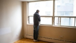 Chris Bell, who has been on the streets for the past 24 years, looks out of the window of a temporary apartment he is housed in by the City of Toronto with the help of The Sanctuary, a respite centre he has been attending for the last 20 years, on April 30, 2020. THE CANADIAN PRESS/Chris Young