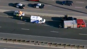 A vehicle with an orange tarp covering its front is seen on Highway 401 after a fatal flying wheel incident on Aug. 12, 2020. (Chopper 24)