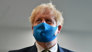File - In this Monday, July 13, 2020 file photo, Britain's Prime Minister Boris Johnson, wearing a face mask, visits the headquarters of the London Ambulance Service NHS Trust in London, Monday July 13, 2020. (Ben Stansall/Pool via AP, File)