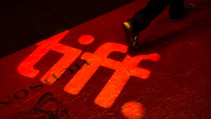 A star-studded awards fundraiser from the Toronto International Film Festival will air on CTV, with Oscar-winning actor Anthony Hopkins among the newly announced honorees. A man walks on a red carpet displaying a sign for the Toronto International Film Festival at the TIFF Bell Lightbox in Toronto on Wednesday, September 3, 2014. THE CANADIAN PRESS/Darren Calabrese