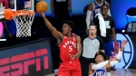 Toronto Raptors' Stanley Johnson (5) goes up for a basket against Philadelphia 76ers' Matisse Thybulle (22) during the second half of an NBA basketball game Wednesday, Aug. 12, 2020 in Lake Buena Vista, Fla. (AP Photo/Ashley Landis, Pool)