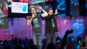 "Craig Kielburger and Marc Kielburger speak during ""We Day"" in Toronto on Thursday, Oct. 2, 2014. THE CANADIAN PRESS/Hannah Yoon"