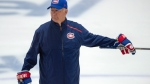 FILE - Montreal Canadiens head coach Claude Julien gives instructions during NHL hockey practice in Brossard, Quebec, Tuesday, July 14, 2020. Canadiens general manager Marc Bergevin says coach Claude Julien was experiencing chest pains Wednesday, Aug. 12, 2020 and was taken by ambulance to a Toronto hospital. (Ryan Remiorz/The Canadian Press via AP)