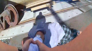 This photo from body camera video carried by Lodi, Calif., Police Officer Erika Urrea as she pulls a man from the path of a passing train on Wednesday, Aug. 13, 2020. The man in a wheelchair was stuck on railroad tracks seconds before the train came past, in a dramatic rescue caught on the officer's body camera. ( Lodi Police Department via AP)