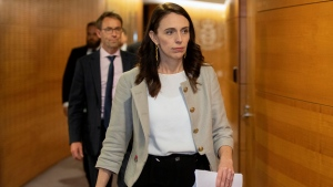 New Zealand Prime Minister Jacinda Ardern walks to a press conference in Wellington, New Zealand, Friday, Aug. 14, 2020. Ardern announced that the three-day lockdown in Auckland would be extended by another 12 days at level 3, the rest of New Zealand will stay at level 2 restrictions as health authorities investigate the source of the first domestic coronavirus outbreak in more than three months. (Mark Mitchell/New Zealand Herald via AP)