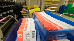 FILE - In this Aug. 5, 2020, file photo, vote-by-mail ballots are shown in sorting trays at the King County Elections headquarters in Renton, Wash., south of Seattle. (AP Photo/Ted S. Warren, File)