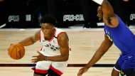 Toronto Raptors' Stanley Johnson (5) drives against Denver Nuggets' Noah Vonleh, right, during the fourth quarter of an NBA basketball game Friday, Aug. 14, 2020, in Lake Buena Vista, Fla. (Mike Ehrmann/Pool Photo via AP)