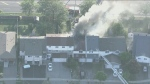 Firefighters are battling a two-alarm blaze at Scarborough townhouse.