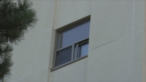 A mother and four police officers rescued a child hanging from a 6th floor apartment window in Mississauga.
