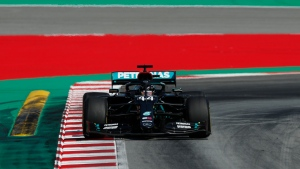 Mercedes driver Lewis Hamilton of Britain steers his car during a practice session prior to the Formula One Grand Prix at the Barcelona Catalunya racetrack in Montmelo, Spain, Friday, Aug. 14, 2020. (Albert Gea, Pool via AP)