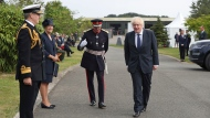 Britain's Prime Minister Boris Johnson arrives to attend the national service of remembrance marking the 75th anniversary of VJ Day at the National Memorial Arboretum in Alrewas, England, Saturday Aug. 15, 2020. (Peter Byrne/PA via AP)