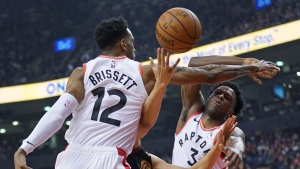 Toronto Raptors' Oshae Brissett (12) and teammate OG Anunoby (3) defend against Cleveland Cavaliers' Dante Exum (1) during first half NBA basketball action in Toronto on Tuesday, Dec. 31, 2019. THE CANADIAN PRESS/Hans Deryk