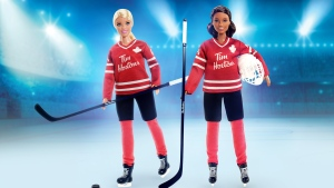 A spokeswoman for Tim Hortons says its restaurants won't be selling a new Barbie made in collaboration with the coffee chain until both Black and white versions of the hockey-themed dolls, seen in an undated handout photo, are available. THE CANADIAN PRESS/HO-Tim Hortons,