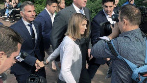In this Aug. 27, 2019, file photo, Lori Loughlin departs federal court with her husband, clothing designer Mossimo Giannulli, left, in Boston, after a hearing in a nationwide college admissions bribery scandal. Loughlin and Giannulli have agreed to plead guilty in a video arraignment scheduled for Friday, May 22, 2020, to charges of trying to secure the fraudulent admission of their two children to the University of Southern California as purported athletic recruits. (AP Photo/Philip Marcelo, File)