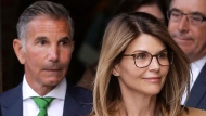 In this April 3, 2019 file photo, actress Lori Loughlin, front, and husband, clothing designer Mossimo Giannulli, left, depart federal court in Boston. (AP Photo/Steven Senne, File)