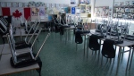 A empty classroom is pictured at Eric Hamber Secondary school in Vancouver, B.C. Monday, March 23, 2020. THE CANADIAN PRESS/Jonathan Hayward