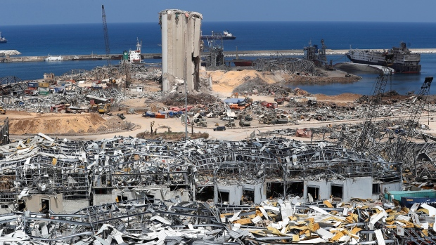 Lebanese army, rescue teams and investigators work at the scene of Aug. 4 explosion that hit the seaport of Beirut, Lebanon, Wednesday, Aug. 19, 2020. (AP Photo/Hussein Malla)