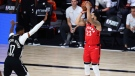 Toronto Raptors guard Fred VanVleet (23) hits a 3-pointer over Brooklyn Nets guard Garrett Temple (17) during the second half of Game 4 of an NBA basketball first-round playoff series, Sunday, Aug. 23, 2020, in Lake Buena Vista, Fla. (Kim Klement/Pool Photo via AP)