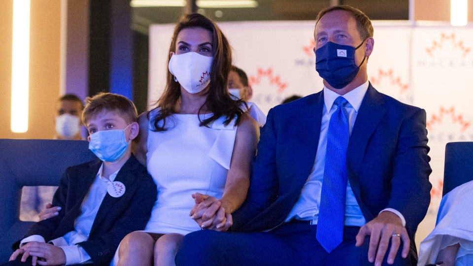 Peter MacKay, leadership candidate for the Conservative Party of Canada, watches a broadcast show that will announce the party's new leader with his wife Nazanin Afshin-Jam MacKay and son Kian, 7, in Ottawa on Sunday, Aug. 23, 2020. THE CANADIAN PRESS/Justin Tang