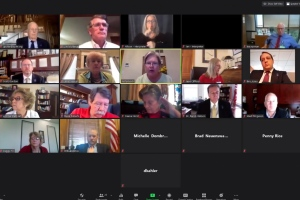 An Associated Press computer screen capture shows the Kansas State Board of Education meeting by Zoom with staff members and other state officials watching, Wednesday, July 22, 2020, in Topeka, Kan. (Kansas State Board of Education via AP)