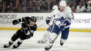 Toronto Maple Leafs' Kasperi Kapanen, right, skates in front of Los Angeles Kings' Blake Lizotte (46) during the first period of an NHL hockey game Thursday, March 5, 2020, in Los Angeles. (AP Photo/Marcio Jose Sanchez)