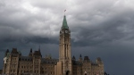 Storm clouds pass by the Peace tower and Parliament hill Tuesday August 18, 2020 in Ottawa. THE CANADIAN PRESS/Adrian Wyld