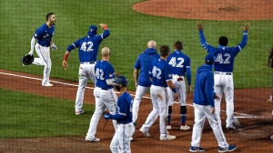 Toronto Blue Jays' Randal Grichuk, left, celebrates his two-run walkoff home run against the Baltimore Orioles during the 10th inning of a baseball game in Buffalo, N.Y., Friday, Aug. 28, 2020. (AP Photo/Adrian Kraus)