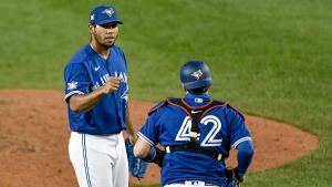 Toronto Blue Jays pitcher Wilmer Font, left, and catcher Danny Jansen celebrate the team's 5-0 win in a baseball game against the Baltimore Orioles in Buffalo, N.Y., Saturday, Aug. 29, 2020. (AP Photo/Adrian Kraus)