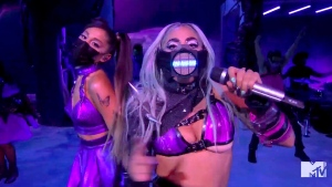 "In this video grab issued Sunday, Aug. 30, 2020, by MTV, Ariana Grande, left, and Lady Gaga perform ""Rain On Me"" during the MTV Video Music Awards. (MTV via AP)"