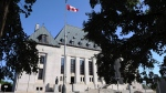 The Supreme Court of Canada in Ottawa on Tuesday, July 10, 2012. An Alberta woman who was granted a new trial by the Supreme Court of Canada has pleaded guilty to manslaughter in the fatal shooting of her domestic partner. THE CANADIAN PRESS/Sean Kilpatrick