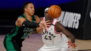 Boston Celtics' Grant Williams (12) passes in front of Toronto Raptors' Pascal Siakam (43) in the first half of an NBA conference semifinal playoff basketball game Tuesday, Sept. 1, 2020, in Lake Buena Vista, Fla. (AP Photo/Mark J. Terrill)