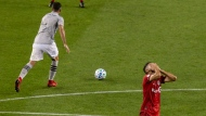 Toronto FC's Jonathan Osorio reacts after a turn over as Montreal Impact's Rudy Camacho takes the ball away during second half MLS soccer action against the Montreal Impact, in Toronto, Tuesday, Sept. 1, 2020. THE CANADIAN PRESS/Chris Young