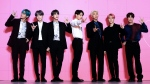 "FILE - Members of South Korean K-Pop group BTS appear during a press conference in Seoul, South Korea, on April 17, 2019. ""Dynamite,"" the group's first all-English song, debuted at No. 1 on the U.S. music charts this week, making BTS first Korean pop act to top the chart. (Jo Soo-jung/Newsis via AP, File)"