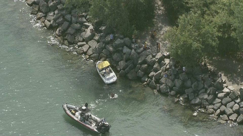 One person has been rushed to hospital in critical condition following a boat crash at Woodbine Beach.