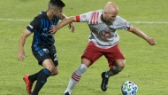 Montreal Impact's Emanuel Maciel, left, challenges Toronto FC's Michael Bradley during second half MLS soccer action in Montreal, Friday, August 28, 2020. Toronto FC prepares to head west to face the Vancouver Whitecaps on the weekend with a question-mark over captain Michael Bradley, the victim of a nasty tackle in the dying moments of Tuesday's loss to visiting Montreal. THE CANADIAN PRESS/Graham Hughes