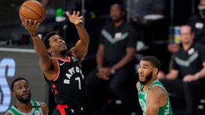 Toronto Raptors' Kyle Lowry (7) shoots between Boston Celtics' Kemba Walker, left, and Boston Celtics' Jayson Tatum, right, in the first half of an NBA conference semifinal playoff basketball game Thursday, Sept 3, 2020, in Lake Buena Vista Fla. (AP Photo/Mark J. Terrill)
