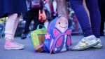 A school bag and a lunch bag are seen in the school yard at the Bancroft Elementary School as students go back to school in Montreal, on Monday, August 31, 2020. THE CANADIAN PRESS/Paul Chiasson