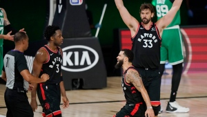 Toronto Raptors' Fred VanVleet, center, and Marc Gasol (33) celebrate with OG Anunoby (3) after Anunoby hit the game winning shot over the Boston Celtics during an NBA conference semifinal playoff basketball game Thursday, Sept. 3, 2020, in Lake Buena Vista, Fla. Anunoby's muted response came as no surprise to his high school coach, however. Blair Thompson says Anunoby has always carried an understated swagger in high-pressure situations. THE CANADIAN PRESS/AP/Mark J. Terrill