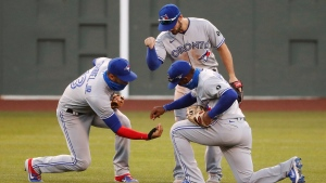 Toronto Blue Jays' Lourdes Gurriel Jr., left, Randal Grichuk and Teoscar Hernandez, front right, celebrate after the team's 8-7 win over the Boston Red Sox in the first game of a baseball doubleheader Friday, Sept. 4, 2020, at Fenway Park in Boston. (AP Photo/Winslow Townson)