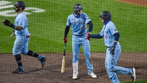 Toronto Blue Jays' Danny Jansen, right, is congratulated by Cavan Biggio, center, after hitting a grand slam against the New York Yankees during the sixth inning of a baseball game in Buffalo, N.Y., Monday, Sept. 7, 2020. (AP Photo/Adrian Kraus)