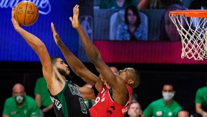 Boston Celtics' Jayson Tatum (0) tries to get a shot over Toronto Raptors' Serge Ibaka (9) during the second half of an NBA conference semifinal playoff basketball game Monday, Sept. 7, 2020, in Lake Buena Vista, Fla. (AP Photo/Mark J. Terrill)