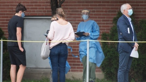 People wait to be tested for COVID-19 outside a COVID-19 testing clinic in Montreal, Monday, September 7, 2020, as the pandemic continues in Canada and around the world. THE CANADIAN PRESS/Graham Hughes