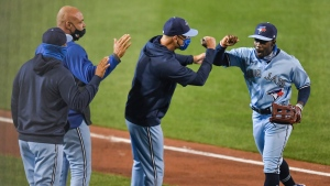 Toronto Blue Jays right fielder Jonathan Davis, right, and teammates celebrate a 2-1 win over the New York Yankees in a baseball game in Buffalo, N.Y., Tuesday, Sept. 8, 2020. (AP Photo/Adrian Kraus)
